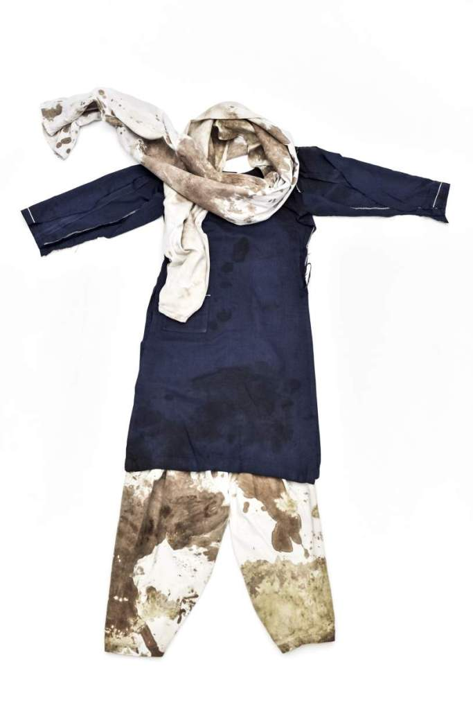 The school uniform of Malala Yousafzai, Nobel Peace Prize laureate 2014. Malala was wearing the uniform on the day she was shot in the head by the Taliban while on the school bus in Swat, Pakistan, on 9 October 2012.   Photo: Lynsey Addario / Reportage by Getty for the Nobel Peace Center Honouring Malala Yousafzai's own wish, the school uniform she wore when she was shot in the head by a Taliban gunman in October 2012, becomes part of the Nobel Peace Prize laureate exhibition 2014 – Malala and Kailash at the Nobel Peace Center in Oslo, Norway.